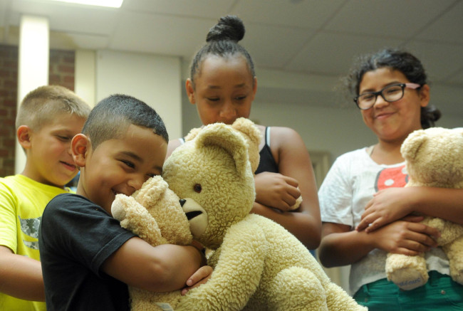 Snuggle visits campers at the Boys & Girls Club of Greenwich, CT, Thursday, Aug. 20, 2015.  (Photo by Diane Bondareff/Invision for Snuggle)